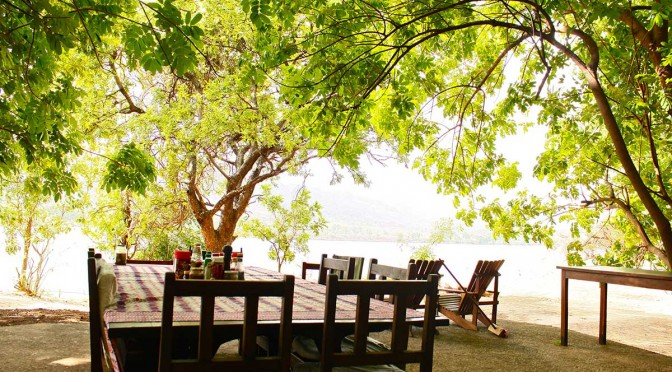dining outside at zambezi fishing lodge