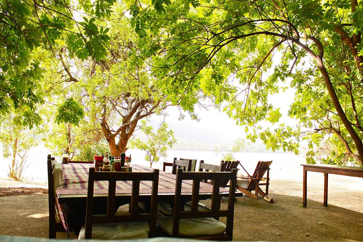 dining outside at zambezi fishing lodge